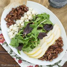 Blue Cheese and Pear Salad | A perfect fall or winter salad with candied pecans and a maple vinaigrette from thatskinnychickcanbake.com @lizzydo