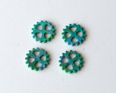 On Sale 'til Sept. 16th - Price Reduced from $5.00 to $4.00 These gear charms would be a great addition to a unique jewelry design or use them for a pair of earrings. Each of these gear charms were individually painted with Vintaj patina inks. Measures: approximately 1/2 inch long each PLease, contact me PRioR to purchase with any questions you have about this item. Packaged with care and Shipped promptly.