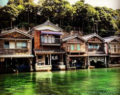 Located on the shore of Ine Bay in Kyoto Prefecture is a group of 230 funaya, or boat houses. Known as Ine no Funaya, or The Boat Houses of Ine, the wooden buildings are built on the water's edge and feature garage-like openings which act as boat moorings for their residents.