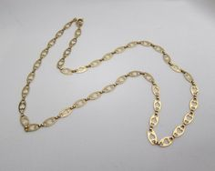 Circa 1910. This is a beautiful Edwardian 18KT yellow gold chain with French punch marks.