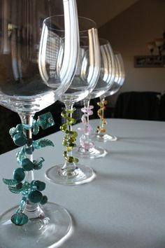 Homemade wine glass charms using wire and beads. Turned out great!