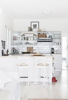 White kitchen from relaxed Central Coast home with ocean views and fresh neutral decor. Photography: Maree Homer | Story: homes+