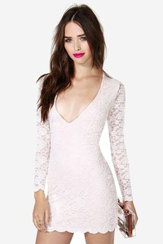 Gorgeous blush dress featuring a lace overlay and scalloped hem and cuffs. Deep V neckline, mega ...
