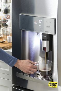 Does your refrigerator serve you coffee? We've got one that would. The GE Profile Refrigerator with Keurig K-Cup Brewing System is the ultimate in convenience—just pop in a K-Cup, select your serving size, and get fresh, filtered water for brewing. And there's no need to ever refill. More space on your counter; more time in your morning.
