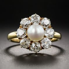 Victorian Natural Pearl and Diamond Ring.  A classic, antique (mid-to-late-nineteenth century) 'halo' ring, crafted in rich 18K gold, starring a lustrous 7.1 millimeter natural pearl encircled by eight bright-white and sparkling old mine-cut diamonds which collectively total 2.00 carats.