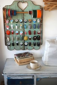 A lovely ribbon and thread storage display
