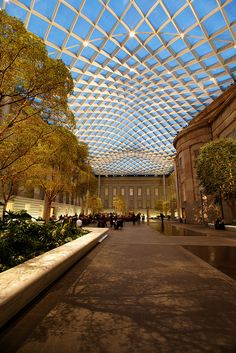 It's the Smithsonian American Art Museum, the National Portrait Gallery, the Archives of American Art Gallery, and the Luce Foundation visible art storage and study center, all rolled into one. Plus the beautiful covered Kogod courtyard. Atrium Design, Roof Design, Shading Device, Archives Of American Art, Art Storage, Roof Architecture, Canopy Design, Pergola With Roof, National Portrait Gallery