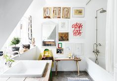 Gravity Home: Bright bathroom with artwork