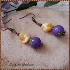 Hey, I found this really awesome Etsy listing at https://www.etsy.com/listing/187657291/purple-glass-bead-earrings-purple-and