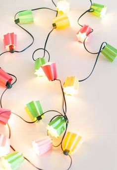 These DIY Paper Folded Light Strands are a fun way to dress up your home decor or spice up a party! Diy Paper, Paper Crafts, Diy Crafts, Crafts For Teens, Arts And Crafts, Paper Bunny, Origami, Papier Diy, Do It Yourself Wedding