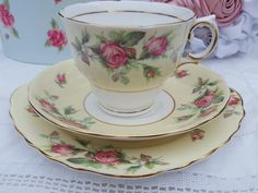 Colclough Harlequin Ballet pale yellow with red bud roses.