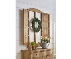 This Eased Arch Double Door Window Casing will become the stand out focal point in your home. It's a gorgeous wall décor accent designed by Joanna with an arched center top and panel doors on each side. Looks splendid placed over sideboards, buffets or beds. It comes in a Wheat finish.
