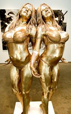 Artist Marc Quinn built the pair of shiny, open-armed Baywatch babes for his show about people who've transformed themselves.