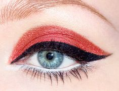 Coral Eye Shadow And Winged Liner.
