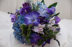 Morning glory wedding bouquet needs lilly of the valley and sweet pea flowers and it would be perfection. my birth flower is morning glory and they can be blue so that would be perfect