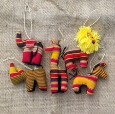 A set of Stuffed Animal Ornaments in a Ugandan Kikoy fabric. Support global artisans and bless vulnerable children.