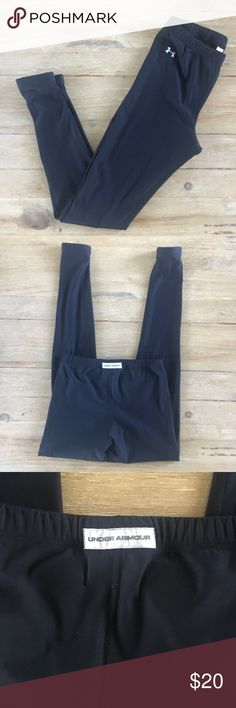 """Under Armour running tights leggings. Under Armour running tights workout leggings.  Black with white logo.   Inseam is approx 27.5"""".    64% nylon, 21% polyester, and 15% elastane.  Perfect condition. Under Armour Pants"""