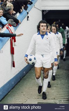 4th November 1972. Leicester City forward Keith Weller leads out team mates Dennis Rofe, Len Glover and Peter Shilton against Manchester United at Filbert Street. The Foxes wore an all white strip because the match was broadcast on television. Most people still had black and white televisions so the home side changed to avoid a clash.