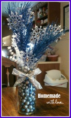 Frost #holiday #centerpiece www.homemadewithloveweddings.com