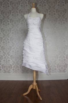 Halter neck dropped waist hi-low hem gown