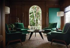 The chairs in the library are covered in Robert Allen Beacon Hill deep green…