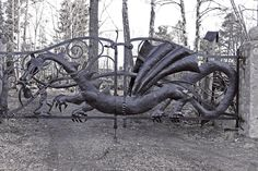 A gate made by the blacksmith Martin Ahlsén. From:  Dragon gate by guru-13.deviantart.com on @deviantART