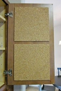 RV and travel trailer organization and storage solution - cork board inside cupboard for notes