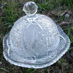 Round pressed glass butter dish inherited from a great-grandmother...probably about 100 years old