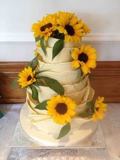 Win carrot cake cupcakes from the yummy cake company White Chocolate Wedding Cake decorated with Sunflowers - The Yummy Cake Company