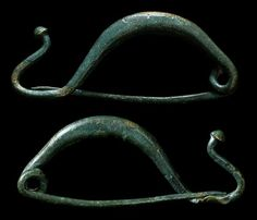 """Ancient Greece, 5th-4th century BC. Fantastic bronze fibula. Intact! Great olive-green patina. 44 mm (1 3/4"""") long. A very nice example.:"""