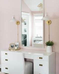 Mounted to a pink wall, Aerin Charlton Sconces are positioned on either side of a white framed mirror hung from a pink wall over an RH Teen Avalon Storage Desk seating a white slipper chair. Kitchen Paint Colors, Desk Storage, Visual Comfort, Pink Walls, Luxury Interior Design, Model Homes, House Tours, Luxury Homes, Home Goods