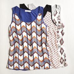 I love these tops.  I tend to prefer chevron prints, but love the ikat in this photo.