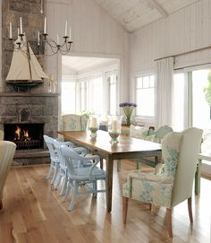 In the Dining Room  Designer Sarah Richardson, from HGTV's Sarah's House, used a wide-stripe fabric from Schumacher, aptly named Summerside, on the back of the armchairs in the lovely white dining room of her summer cottage. Richardson also piled on pillows in fanciful patterns, including a blue paisley.