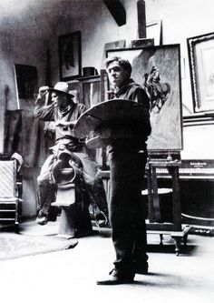 """N.C. Wyeth in his studio as he paints """"Rounding Up,"""" with Allen Tupper True on the saddle posing for the painting. Photographer unknown, ca. 1905. Allen Tupper True Papers, Archives of American Art, Smithsonian Institution, Washington, D.C."""
