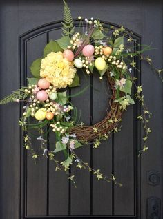 An original design by An Extraordinary Gift ©  I started with an 18 grapevine base. I then added wispy branches, berries, glitter pink, green, yellow and peach eggs and a yellow hydrangea to create a perfect combination for the perfect design. Love it!  This design measures approx. 20 in diameter extending up to 34 and would look wonderful on any door or wall in your home.  Giving An Extraordinary Gift is perfect for all occasions.  Sending a gift?? Have a question?? Convo me anytime! I…