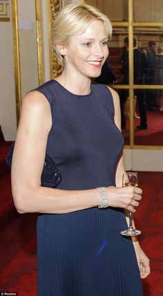 Princess Charlene of Monaco attends a banquet to celebrate the 2012 Olympics at Buckingham Palace.