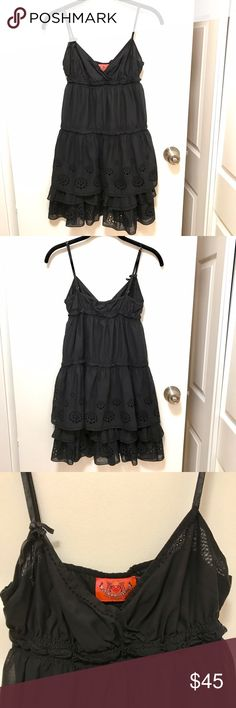 Juicy Couture summer dress Juicy Couture summer dress. 100% cotton. Adjustable satin straps. Adorable cut out and ruffle details. Perfect for summer!! Size P. Juicy Couture Dresses