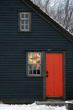 New England Cottage Detail.orange/red door on antique blue/black house; window directly adjacent to door. The Doors, Windows And Doors, Front Doors, Sash Windows, Pintura Exterior, Home Goods Decor, Painted Doors, Wooden Doors, Rustic Doors