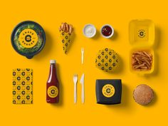 Check out the great Hamburger Branding and Packaging for Crave Burger, a great design in black and yellow that goes great with burgers. Burger Branding, Burger Packaging, Food Branding, Food Packaging Design, Restaurant Identity, Burger Restaurant, Restaurant Design, Menu Design, Food Design