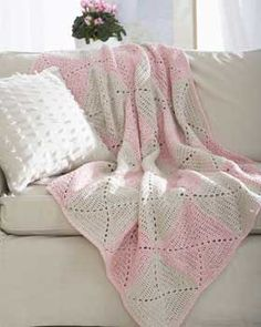 This is such a lovely and dainty crochet afghan pattern for you to put together. Girls will especially appreciate the white and rose motifs and eyelet design used to create this beautiful afghan.