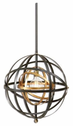This Rondure sphere pendant light features a dark oil-rubbed bronze hue with French gold and antiqued brass accents.