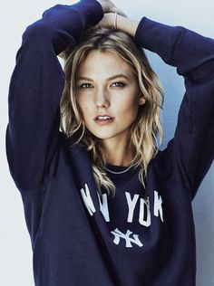 The face of Express, Karlie Kloss, gets her closeup in the September 2015 issue of the UK's Sunday Times Style. Posing for Emma Tempest, the American beauty layers up in fall outwear and knits for the colorful feature. Styled by Lucy Ewing, Karlie shows off bold, blue eyeshadow as well as messy waves. / Hair …
