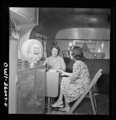 Middle River, a small crossroads in the vicinity of Baltimore, Maryland. FSA (Farm Security Administration) housing project (later administered by the National Housing Agency) for Glenn L. Martin aircraft workers. Mrs. Helen Bird, USO (United Service Organization) traveler's aide, giving information to a newcomer in the Glenn L. Martin trailer village. Date: 1943 Aug.? Photographer: John Collier | FSA-OWI Photograph Collection (Library of Congress) | #USO