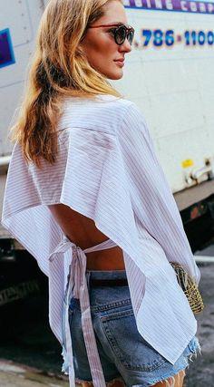 Sofía Sanchez de Betak in a Tome top, cutoff denim shorts, and a Anndra Neen bag