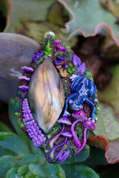 My name is Kristina Matthews, creator, and owner of Channelled Creations small family business of handmade art and jewelry. Our most famous design is Magic Portal necklace. One of a kind miniature world that can take up to 30 hrs to create.