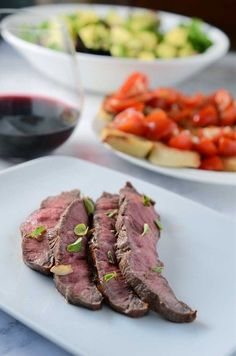 Flat iron steak is marinated with fresh oregano, olive oil, vinegar and garlic and then grilled to perfection.