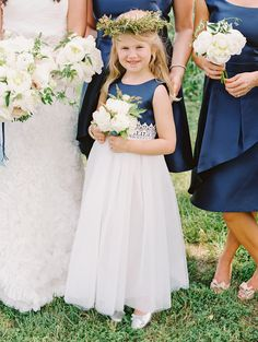 Adorable flower girl in navy: http://www.stylemepretty.com/little-black-book-blog/2016/04/22/this-sapphire-ring-kicked-off-one-beautiful-blue-party/ | Photography: Katie Stoops - http://katiestoops.com/