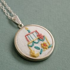 How to make embroidered jewelry with instructions, supply sources and helpful photos.