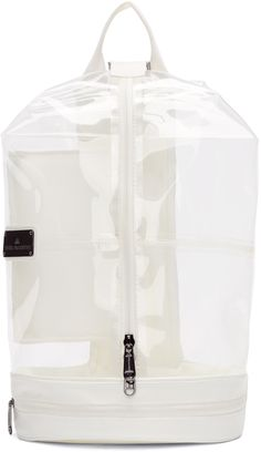 Unstructured transparent vinyl backpack featuring panelling in white throughout. Grosgrain carry handle at top. Detachable and adjustable grosgrain shoulder straps with lobster clasp and d-ring fastenings. Two-way zip closure at main compartment. Logo plaque at face. Zippered compartment at reinforced base. Partial mesh lining in white. Gunmetal-tone hardware. Tonal stitching. Approx. 14