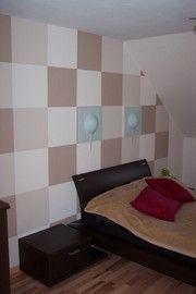Schachbrettmuster an der Wand vergrößert das Schlafzimmer mit Dachschräge. Malerarbeiten von Markus Karger Maler- und Lackierermeister aus Mülheim an der Ruhr (45470) | Maler.org